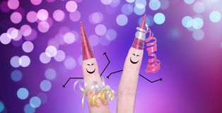 Very cute finger couple celebrating New Year`s Eve. Cute finger couple celebrating New Yeair`s Eve stock photo