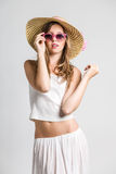 Very cute girl with sunglasses. Looking at camera Stock Photo