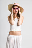 Very cute girl with sunglasses and straw hat. Looking at camera Stock Images