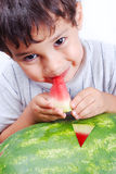 Very cute kid eating watermelon Stock Photos
