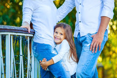 Very cute little blonde girl holding the foot mom Stock Photo
