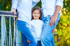 Very cute little blonde girl holding the foot mom Royalty Free Stock Photography