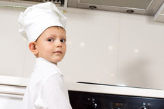 Very Cute Little Chef Looking at Camera Royalty Free Stock Images