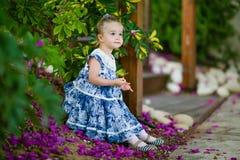 Very cute little girl in a blue dress Stock Photos