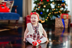Very cute little girl with a bow on his head on the background o Royalty Free Stock Photos