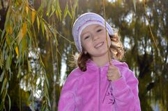Very cute little girl in a pink blouse stock images