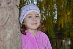 Very cute little girl in a pink blouse royalty free stock photos