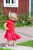 Very cute little girl in red summer dress Stock Image