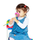 Very cute little girl smelling a flower Royalty Free Stock Photos