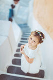 Very cute little princess outdoors in city street Stock Photography