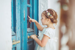 Very cute little princess outdoors in city street Royalty Free Stock Images