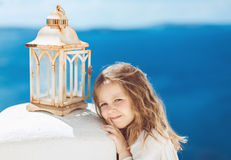 Very cute little princess outdoors in city street Stock Photo