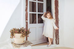 Very cute little princess outdoors in city street Royalty Free Stock Photography