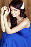 Very cute sensual beautiful girls brunette smiling with closed e. Yes, in a blue dress Royalty Free Stock Photo