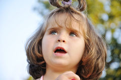 Very cute very little girl outdoor closeup Stock Photo