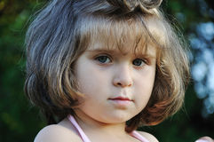Very cute very little girl outdoor closeup Stock Image