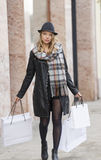 Very cute woman with hat oing for shopping Stock Photo