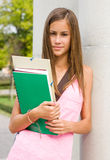 Very cute young student girl outdoors. Stock Photo