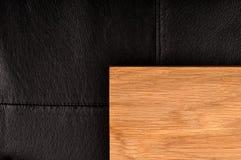 Very dark black leather and oak wood background. Very dark black leather oak wood background Royalty Free Stock Photo