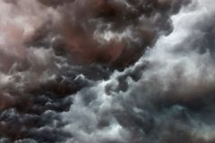 Very dark cloud formations of a heavy thunderstorm during sunset royalty free stock photography