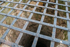 Very deep old water well. Stock Image