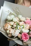 Very delicate handmade bouquet in the hands of the girl florist, a great gift, fresh stock images