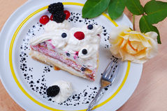 Very delicious cake with rose on plate Stock Photography