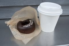 Chocolate donut with hot coffee Royalty Free Stock Photo