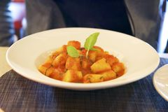 Plate of gnocchi served on a large plate stock photo