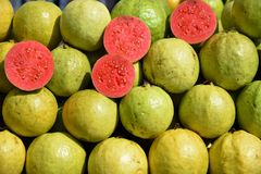 Very Delicious red Guava is a common tropical fruit cultivated in India. This naturally grown red guava is only found in state of Gujarat, especially in north stock images