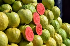 Very Delicious red Guava is a common tropical fruit cultivated in India. This naturally grown red guava is only found in state of Gujarat, especially in north stock photography
