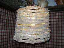Wicker lamp, piece of rustic handicraft royalty free stock photo