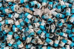 Very dirty blue PVC pipe stack together Stock Photography