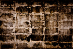 Very dirty brick wall. Very old and dirty gray brick wall stack in row Royalty Free Stock Photos