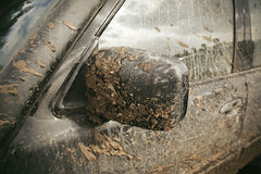 Very Dirty Car. Close-up very dirty and muddy car mirror Stock Images