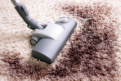 Very dirty carpet. Vacuuming very dirty white  carpet Royalty Free Stock Image
