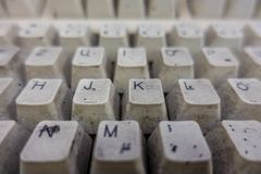 A completely dirty white computer keyboard in a workshop royalty free stock photos
