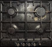 Very dirty gas cooking hob. The Dirty and Grimy and Rusted Top of Gas Cooker Hob. Used for Cooking with Pan appliance background bits burner care clean closeup stock photography