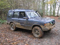 A very dirty muddy offroad car Royalty Free Stock Images