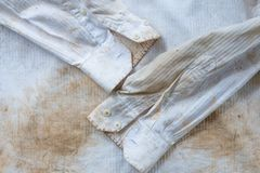 Very dirty and rusty white shirt close up for background use Royalty Free Stock Photography