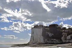 Dramatic sky sea scene in Saint Margaret`s bay in Kent. A very dramatiloudy sky in a sea scene in Saint Margaret`s bay Kent England with a large cliff covered in stock photo