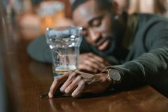 Very drunk african american man. With automobile keys at bar Royalty Free Stock Images