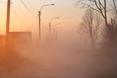 Very dusty rural road on the outskirts of St. Petersburg. At sunset, Russia Stock Image
