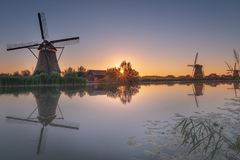 Very early in the morning before sunset at the Kinderdijk in the Alblasserwaard... stock photography
