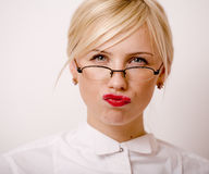 Very emotional businesswoman in glasses, blond hair on white background Royalty Free Stock Image