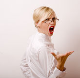 Very emotional businesswoman in glasses, blond hair on white background Royalty Free Stock Photos