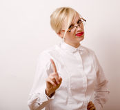 Very emotional businesswoman in glasses, blond hair on white background Stock Photos