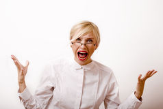 Very emotional businesswoman in glasses, blond Royalty Free Stock Photography