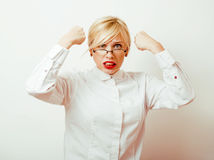 Very emotional businesswoman in glasses, blond hair on white background. teacher hands up posing isolated. pointing Stock Photo