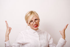 Very emotional businesswoman in glasses, blond Stock Photography